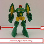 Cosmos in robot mode, standing easily. His feet have been swapped. This image also has arrows pointing to the locations of the pins to remove to swap the feet.