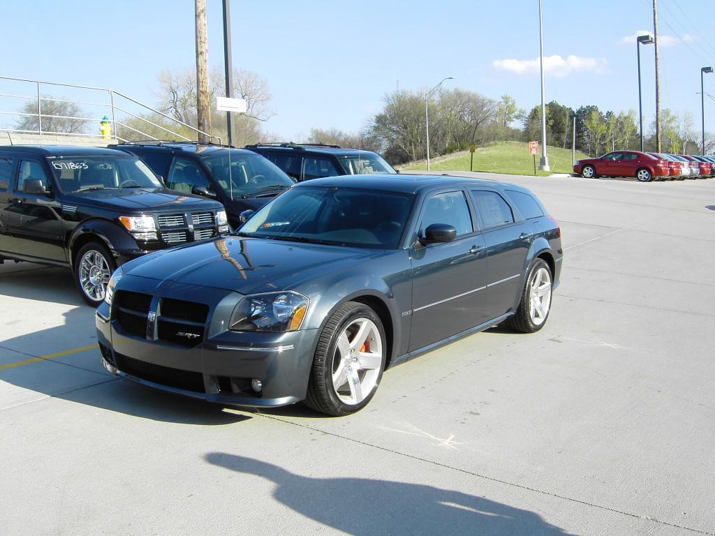Blue Dodge Magnum SRT8 parked in dealer lot