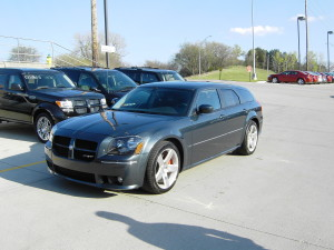 Blue Dodge Magnum SRT8 parked in dealer lot